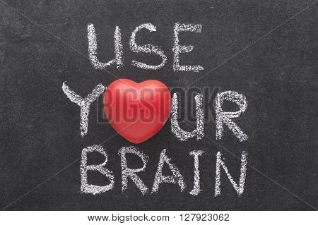 use your brain phrase handwritten on chalkboard with heart symbol instead of O