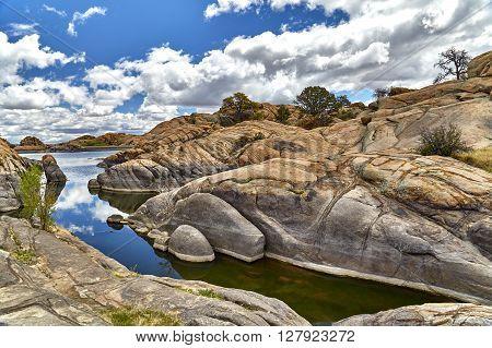 Lake In Boulders Showing Water Line In Rocks