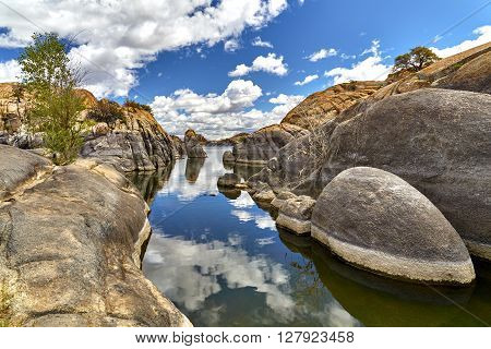 Lake In Boulders Showing Water Line In Rocks