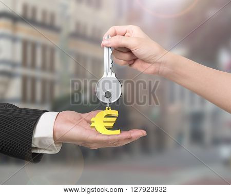 Woman Hand Giving Key Euro Sign Keyring To Man Hand