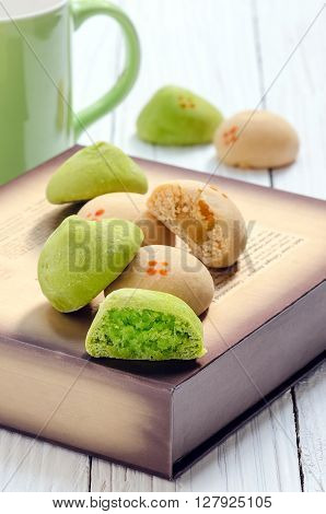Mochi pandanus coconut filling and salted egg bean filling on wooden backgroundLocal dessert of Thailand