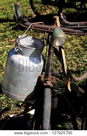 Old Milk Canister And Rusty Historic Bike Milkman