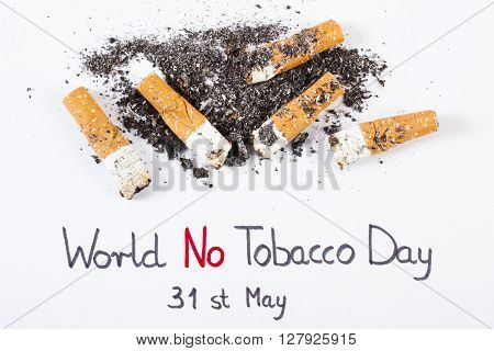 Cigarette butts and ash with inscription world no tobacco day concept of healthy lifestyles without cigarettes