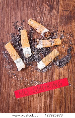 Cigarette butts and ash with inscription no smoking concept of healthy lifestyles without cigarettes world no tobacco day