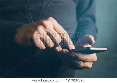 Man sending text message sms communication using mobile smartphone