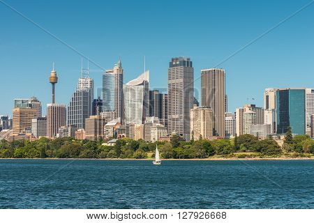 Australian Sydney landmark - city CBD high rises and towers forming megapolis cityscape summer day from harbour. The yacht in the foreground.