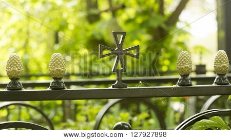 Decorative ornament made of old metal on the fence