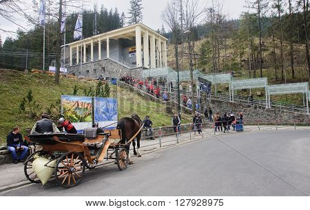 ZAKOPANE POLAND - APRIL 23 2016: Cable car from Zakopane to mount Kasprowy Wierch on 23 April 2016 in Zakopane Poland. View of the lower station of the cableway to mount Kasprowy Wierch - a popular tourist attraction in Zakopane