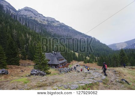 ZAKOPANE POLAND - APRIL 23 2016: Mountain hut on Hala Kondratowa on 23 April 2016 in Zakopane Poland. It is a popular tourist destination for a trip because the area is beautiful