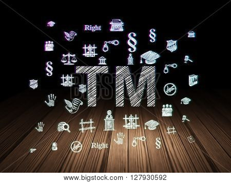 Law concept: Glowing Trademark icon in grunge dark room with Wooden Floor, black background with  Hand Drawn Law Icons