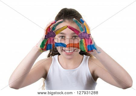 Cute Cheerful Girl Showing Her Hands Painted In Bright Colors,