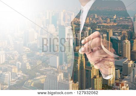 Businessman Writing Something On Transparent Board With City Reflection, Double Exposure