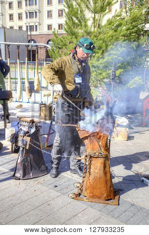 MOSCOW RUSSIA - April 24.2016: Blacksmith works at the fair. Theatre Square in the city center