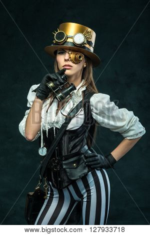 Portrait Of A Beautiful Steampunk Girl With Binoculars
