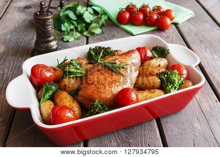 Chicken breast baked with tomato new potatoes and broccoli