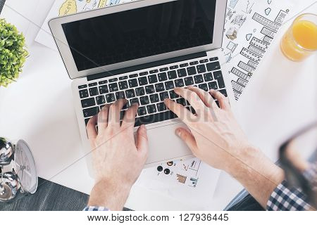 Businessman Typing Top