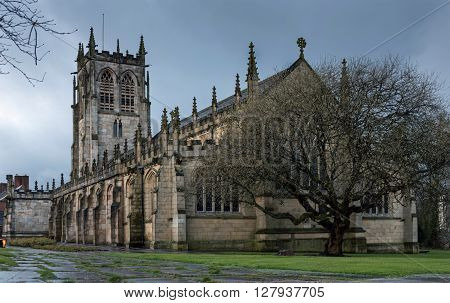 St Chad's Church,Rochdale, England. The oldest part of the church is 12th Century. The church was extensively repaired in 1856 and overlooks the town centre at the top of 122 steps, which lead down to the River Roch.