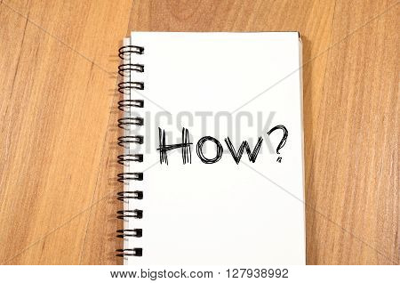 How text concept write on notebook over wooden background