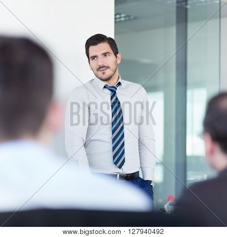 Relaxed team leader and business owner leading informal in-house business meeting. Business and entrepreneurship concept.