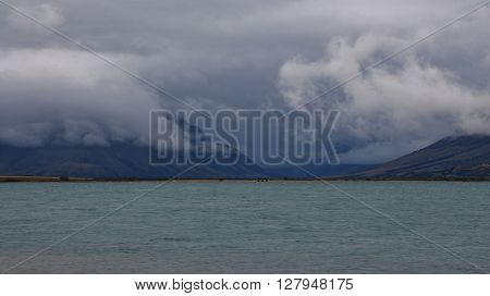 Rainy day in New Zealand. Summer scene at Lake Ohau South Island.