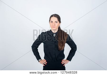 Business woman standing in black suit his hands resting on his hips