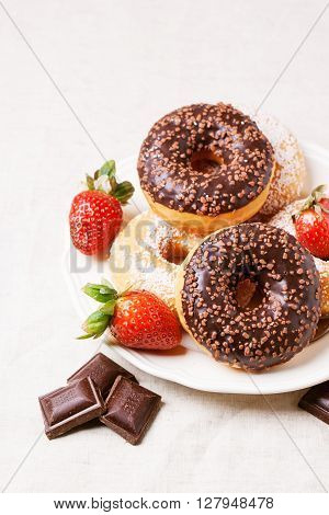 Chocolate Donuts With Fresh Strawberries
