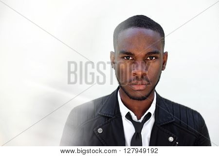 Young Male Fashion Model In Leather Jacket And Tie