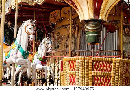 Lovely colorful balloon and horses merry-go-round in Paris
