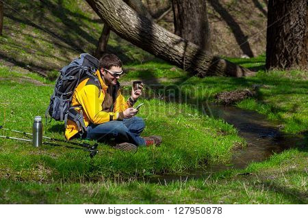 Tourist Man With The Phone In The Forest On Vacation01