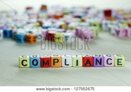 Close up of Compliance word on colorful Dices