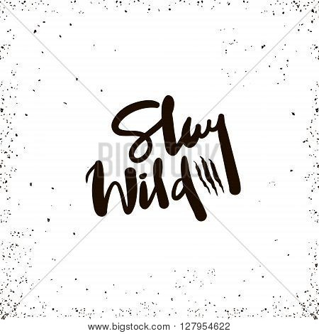 Stay wild inspirational inscription. Hand drawn lettering design. Typography for banner poster or apparel design. Vector typography.