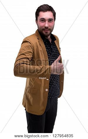 Bearded young man with thumb on white background