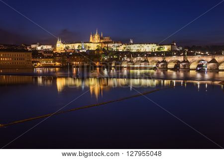Prague city at night Charles Bridge Lobkowicz Palace Hradcany and Prague Castle reflection in river. Prague Czech Republic