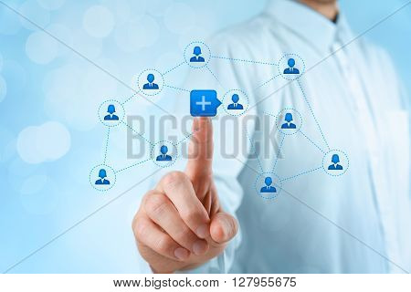 Social media and community concept. Businessman click on plus button to connect new person with community bokeh background.