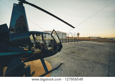 Pilot checking the condition of helicopter before take off. Pilot doing pre flight inspection.