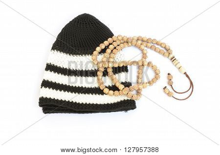 Rosary and prayer cap isolated on white background