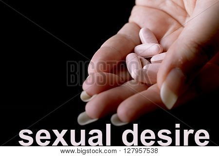 pink pills under female hand for female desire