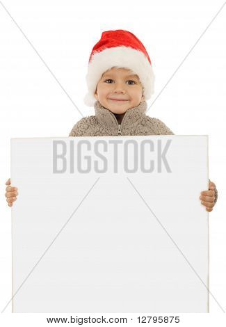 Little boy in Christmas hat with an empty banner