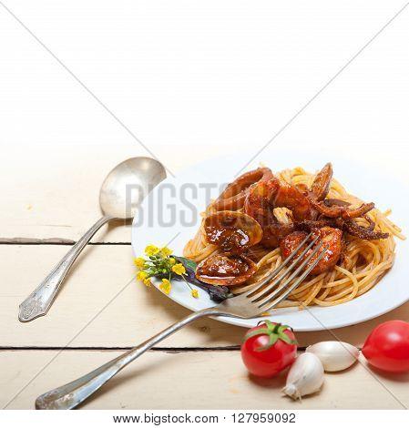 Italian Seafood Spaghetti Pasta On Red Tomato Sauce