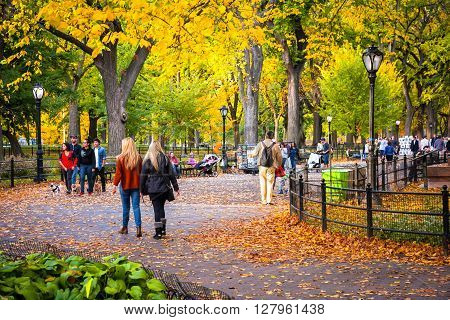 NEW YORK-OCTOBER 29: New Yorkers and tourists enjoy a beautiful Fall day on October 29 2015 on the Mall in Central Park.