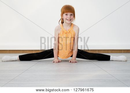 Little Girl Smiling And Doing Stretching