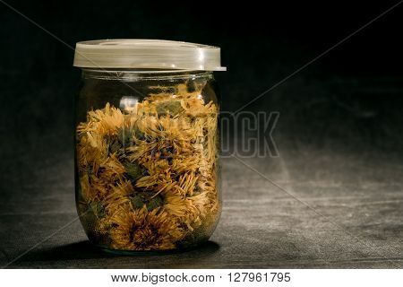 Marigold In Glass Can