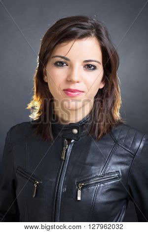 Portrait of a beautiful brunette rocker woman