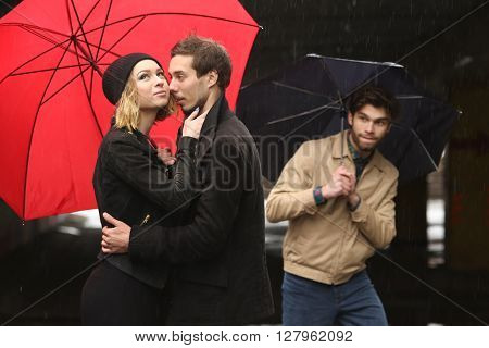 love young people under the red umbrella