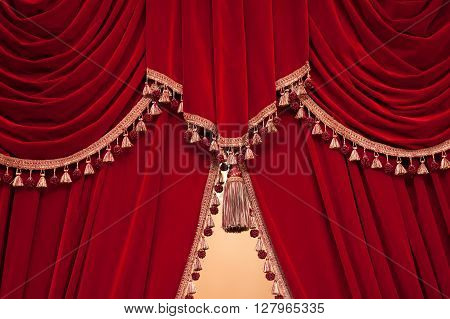red theater curtain with tassels  in theater