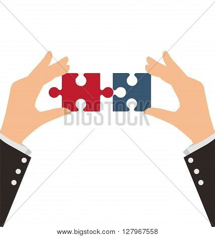 Two Business Hands combining two pieces of puzzle Teamwork Concept
