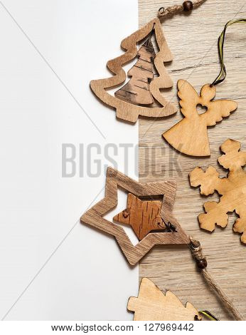 Christmas toys on a wooden table with space for text, top view