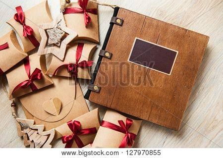 photobook in a wooden cover and wooden toys.
