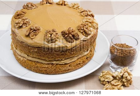 Coffee and walnut cake A traditional coffee and walnut cake covered with butter cream