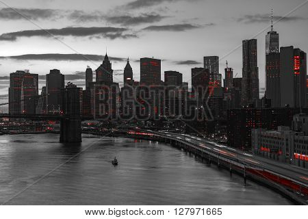 New York City night skyline with red lights in black and white landscape
